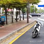 도로 막은 오토바이 신고해도 '견인 불가'