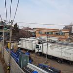 트럭·공장만 '빽빽' 사람 살기 힘든데… 개발용역 중단에 '숨이 턱'